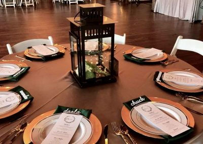 Special occasion table event setup with linen tablecloth chair