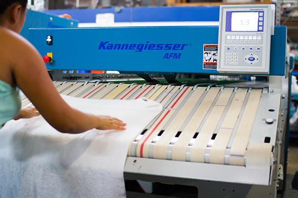 Linen Service Machine and worker
